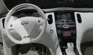 Motor vehicle, Mode of transport, Transport, Product, Steering part, Steering wheel, Automotive design, Photograph, White, Car,