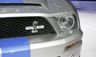 Motor vehicle, Product, Automotive design, Daytime, Automotive exterior, Automotive lighting, Headlamp, Grille, Photograph, White,