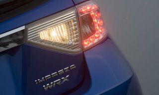 Automotive tail & brake light, Automotive design, Product, Automotive lighting, Automotive exterior, Red, Light, Logo, Electric blue, Technology,