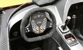 Motor vehicle, Mode of transport, Automotive design, Steering wheel, White, Steering part, Luxury vehicle, Grey, Center console, Supercar,
