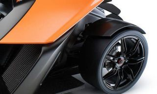 Wheel, Automotive tire, Automotive design, Automotive exterior, Rim, Alloy wheel, White, Automotive wheel system, Synthetic rubber, Tread,