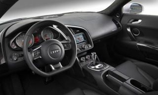 Motor vehicle, Steering part, Mode of transport, Steering wheel, Product, Automotive mirror, Transport, Automotive design, Center console, Photograph,