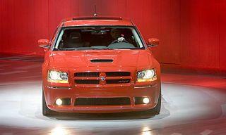 Motor vehicle, Automotive design, Vehicle, Hood, Transport, Automotive exterior, Grille, Car, Automotive lighting, Red,