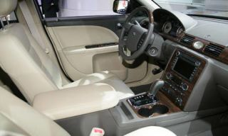 Motor vehicle, Mode of transport, Transport, Steering part, Photograph, Steering wheel, White, Center console, Automotive mirror, Car,