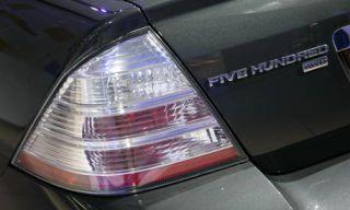 Automotive design, Automotive tail & brake light, Product, Automotive lighting, Automotive exterior, Car, White, Light, Bumper, Luxury vehicle,