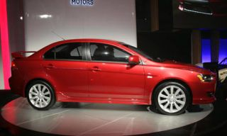 Tire, Motor vehicle, Wheel, Automotive design, Alloy wheel, Rim, Automotive wheel system, Automotive mirror, Red, Car,