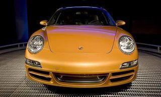 Motor vehicle, Automotive design, Yellow, Vehicle, Land vehicle, Automotive lighting, Car, Hood, Headlamp, Bumper,