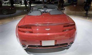 Motor vehicle, Mode of transport, Automotive design, Vehicle, Land vehicle, Vehicle registration plate, Automotive lighting, Car, Photograph, Red,