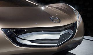 Automotive design, Automotive exterior, Automotive lighting, Photograph, Grille, White, Headlamp, Light, Personal luxury car, Black,