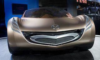 Mode of transport, Automotive design, Product, Automotive exterior, Automotive lighting, Light, Logo, Headlamp, Black, Grille,