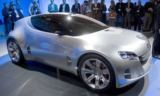 Tire, Wheel, Motor vehicle, Mode of transport, Automotive design, Vehicle, People, Land vehicle, Event, Car,