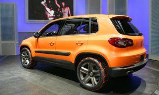 Tire, Motor vehicle, Automotive design, Vehicle, Automotive tire, Land vehicle, Automotive exterior, Car, Rim, Red,