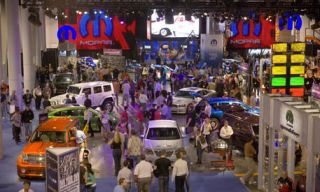 Motor vehicle, Mode of transport, Car, Hood, Traffic, Luxury vehicle, Mid-size car, Market, Classic car, Traffic congestion,