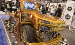 Motor vehicle, Mode of transport, Automotive design, Product, Yellow, Transport, Photograph, Grille, Fender, Automotive tire,