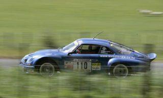 Tire, Vehicle, Car, Rallying, Motorsport, Automotive decal, Sports car, Racing, Alloy wheel, Race car,