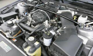 Engine, Automotive engine part, Automotive air manifold, Auto part, Metal, Automotive super charger part, Screw, Nut, Machine, Fuel line,