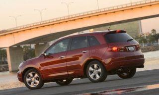 Tire, Wheel, Motor vehicle, Automotive mirror, Mode of transport, Road, Automotive tire, Automotive design, Vehicle, Transport,