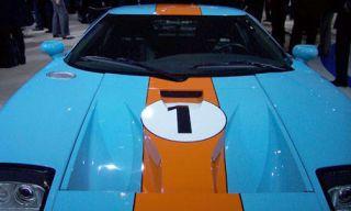 Motor vehicle, Mode of transport, Vehicle, Automotive design, Hood, Car, Automotive exterior, Glass, Windshield, Electric blue,