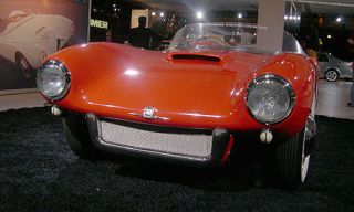 Motor vehicle, Tire, Mode of transport, Automotive design, Transport, Vehicle, Automotive lighting, Red, Photograph, Headlamp,