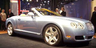 Tire, Wheel, Mode of transport, Automotive design, Vehicle, Land vehicle, Transport, Car, Photograph, Personal luxury car,