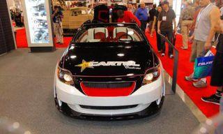 Motor vehicle, Automotive mirror, Mode of transport, Automotive design, Vehicle, Event, Land vehicle, Automotive lighting, Rear-view mirror, Automotive parking light,