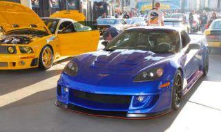 Automotive design, Vehicle, Land vehicle, Yellow, Car, Hood, Sports car, Automotive parking light, Performance car, Bumper,