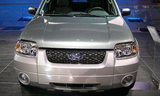Motor vehicle, Product, Automotive design, Automotive exterior, Automotive mirror, Automotive lighting, Vehicle, Glass, Headlamp, Land vehicle,