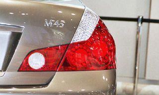 Automotive tail & brake light, Automotive lighting, Red, Automotive exterior, Car, White, Light, Trunk, Bumper, Metal,