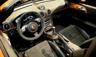 Motor vehicle, Steering part, Mode of transport, Steering wheel, Center console, White, Car, Luxury vehicle, Vehicle audio, Speedometer,