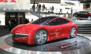 Motor vehicle, Tire, Mode of transport, Automotive design, Transport, Vehicle, Land vehicle, Automotive mirror, Car, Red,