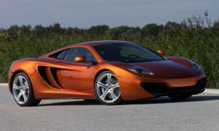 Automotive mirror, Motor vehicle, Mode of transport, Automotive design, Transport, Vehicle, Vehicle door, Automotive exterior, Automotive lighting, Red,
