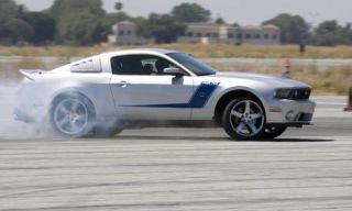 Tire, Wheel, Automotive design, Blue, Automotive tire, Vehicle, Transport, Automotive wheel system, Hood, Automotive exterior,
