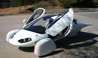 Mode of transport, Automotive design, Nature, Product, Road surface, Road, Asphalt, Photograph, White, Automotive mirror,