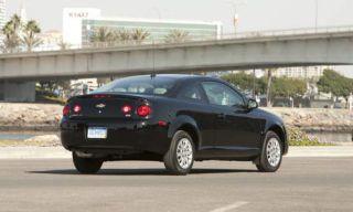 Motor vehicle, Tire, Road, Wheel, Mode of transport, Automotive mirror, Automotive tail & brake light, Vehicle, Automotive design, Automotive tire,