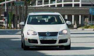 Motor vehicle, Mode of transport, Automotive design, Automotive mirror, Road, Transport, Vehicle, Vehicle registration plate, Headlamp, Infrastructure,