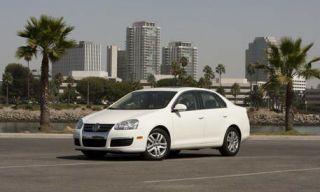 Tire, Wheel, Motor vehicle, Automotive mirror, Mode of transport, Road, Daytime, Vehicle, Transport, Alloy wheel,