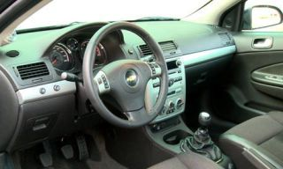 Motor vehicle, Steering part, Mode of transport, Automotive mirror, Product, Transport, Brown, Steering wheel, Automotive design, Center console,