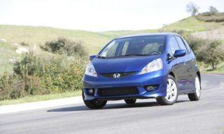 Motor vehicle, Automotive mirror, Tire, Nature, Mode of transport, Blue, Road, Automotive design, Vehicle, Glass,