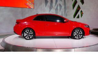 Motor vehicle, Wheel, Mode of transport, Automotive design, Vehicle, Car, Red, Automotive mirror, Mid-size car, Alloy wheel,
