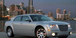 Tire, Motor vehicle, Wheel, Mode of transport, Blue, Daytime, Transport, Tower block, Vehicle, Architecture,