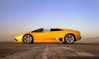 Tire, Motor vehicle, Wheel, Mode of transport, Automotive design, Transport, Automotive mirror, Yellow, Automotive exterior, Vehicle door,