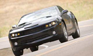 Mode of transport, Automotive design, Road, Yellow, Automotive tire, Vehicle, Automotive lighting, Automotive exterior, Transport, Headlamp,