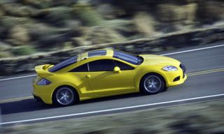 Automotive design, Mode of transport, Road, Yellow, Vehicle, Car, Asphalt, Rim, Fender, Toy,