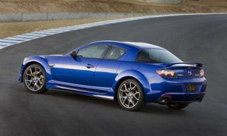 Tire, Wheel, Automotive design, Blue, Vehicle, Automotive tire, Yellow, Road, Alloy wheel, Automotive exterior,