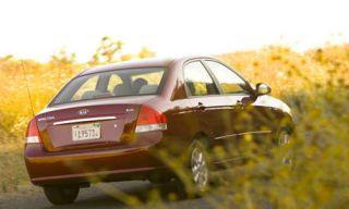 Motor vehicle, Tire, Mode of transport, Automotive tail & brake light, Vehicle, Yellow, Vehicle registration plate, Automotive design, Land vehicle, Car,