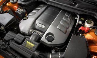 Automotive exterior, Motorcycle accessories, Engine, Machine, Metal, Automotive engine part, Carbon, Luxury vehicle, Personal luxury car, Automotive fuel system,