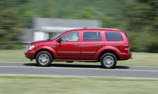 Tire, Motor vehicle, Wheel, Road, Automotive tire, Window, Infrastructure, Red, White, Rim,