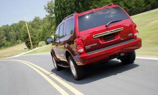 Motor vehicle, Road, Mode of transport, Automotive tail & brake light, Automotive design, Vehicle, Automotive mirror, Automotive tire, Automotive lighting, Land vehicle,