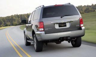 Tire, Motor vehicle, Wheel, Automotive mirror, Automotive tail & brake light, Mode of transport, Road, Automotive tire, Automotive exterior, Vehicle,
