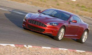 Mode of transport, Automotive design, Vehicle, Hood, Car, Red, Automotive tire, Grille, Rim, Luxury vehicle,